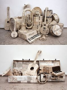 Very clever idea - manuscript covered instruments and map covered suitcases for window displays! Created by Kyle Bean