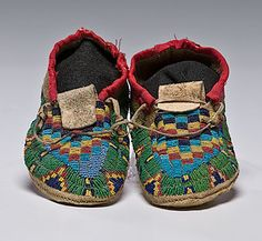 Arapaho Child's Beaded Buffalo Hide Moccasins .  The little person who owned these must have been well loved.