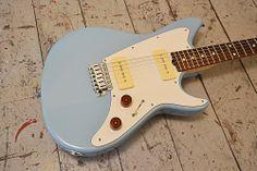 What about a classy retro daphne blue Grosh Guitars?