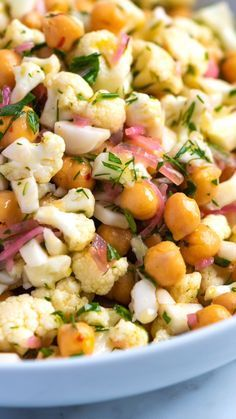Meet my new favorite cauliflower salad recipe. Thanks to a light lemony dressing and lots of fresh herbs, this simple cauliflower salad tastes surprisingly delicious and lasts in the fridge for days. salad Herby Cauliflower Salad with Chickpeas Best Salad Recipes, Veggie Recipes, Whole Food Recipes, Diet Recipes, Vegetarian Recipes, Cooking Recipes, Healthy Recipes, Vegetarian Soup, Crockpot Recipes