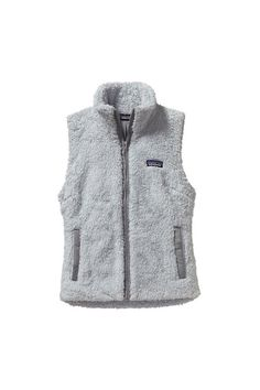 A versatile, extremely soft, deep-pile polyester fleece vest with sleek styling, a tall cozy collar and handwarmer pockets. Specifications: - Made of deep-pile polyester fleece - Long, lean vest with