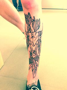 Skull and arrows shin tattoo. I wonder if this person ever got the tattoo colored.