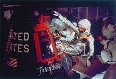 """US astronaut John Glenn enters into the Mercury """"Friendship-7"""" capsule in Cape Canaveral, Florida, on February 20, 1962, prior to the launch of the spacecraft for the first US manned orbital flight ever."""