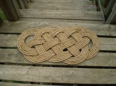 Nautical Doormat PDF Tutorial ~~ how to make a Oceanmat    This listing is for the instructions to make these nautical doormats all by yourself.    A great way to use up some old rope!    You need  100 ft ½ inch Three strand manila rope/ or 1/2 inch rope  2x5ft of jute  Needle, Sharp Knife, Tape, Gardening Gloves, Thread