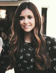 What a wonderful hair color. Cute top too. I frikin love her. Damon forever. <3
