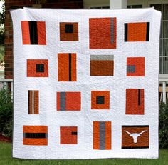 UT quilt    Finally done with the University of Texas quilt for my husband. It's an improv quilt that I designed.