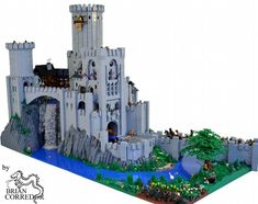 Lego Castle with waterfall, click and check out the detail pics: amazing.    I want to play with legos!