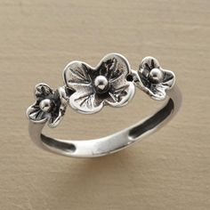 CORSAGE RING�--�A spray of sculpted sterling silver flowers arcs over the finger like a miniature corsage. A Sundance exclusive in whole sizes 5 to 10.