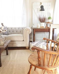 Love this chesterfield sofa and the chippy old door with sconce - so many creative farmhouse decorating ideas in this home tour eclecticallyvintage.com
