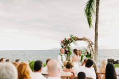 driftwood arch with tropical flowers
