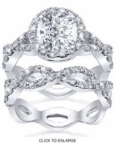 Halo engagement ring with matching wedding band.  Gorgeous.