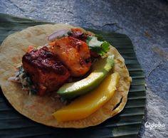 Make these Mega Omega Fish Tacos — it's salmon, mahi mahi, scallops, avocado, and mango over a soft flour tortilla. SO GOOD.