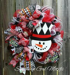 Whimsical Harlequin Snowman wreath!  Check out this item in my Etsy shop https://www.etsy.com/listing/490789165/snowman-christmas-wreath-whimsical