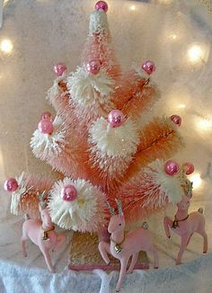 Authentic Vintage Large Pink Frosted Bottle Brush Christmas Tree with Pink Reindeer underneath.