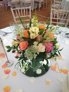 Low cake stand in corals, peaches and creams with roses, lisianthus and dill