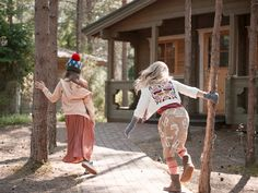 Katrina Tang Photography for Family Traveller magazine Into The Woods 2014 kids fashion. Two girls running in forest, cabin, summer #katrinatang #tangkatrina
