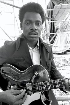 George Benson with his guitar when he was a very young man. I keep thinking this is Eddie Murphy circa early '80s.