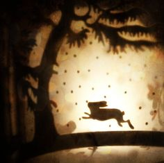rabbit leaps the moon - The silhouette of a rabbit leaps through the glowing moonlight sky in a wintry woodland forest in this multi layered collage photograph.    Title: Rabbit Leaps the Moon  by Missquitecontrary on Etsy