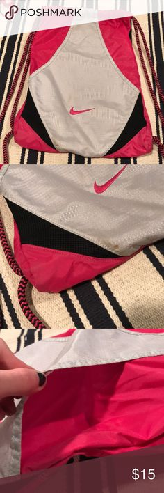 Nike Drawstring Pink Bag Super heavy duty pink drawstring bag! It has pockets on the inside to store things! Has a minor stain on the one corner pictured in the second picture! Nike Bags