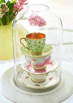 Teacups Displayed Under A Glass Cloche - I have a beautiful collection of mismatched teacups used at my bridal shower from my mom.