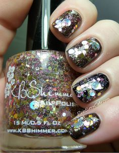 Toast-ess With The Mostest  – created by Christy and Valesha from Peachy Polish – A clear glitter topper loaded with glitters in shades of gold, silver and pink in circles and hex shapes to mimic champagne.  1 Coat Recommended. Over base of Milani Dark Coffee with a plain black creme accent nail
