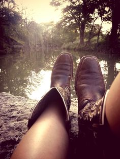 What I'd rather be doing every day instead of working. Cowboy boots kicked up by the creek side.