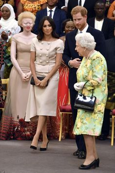 Nice to see you, Ma'am! Meghan proved she had got her curtsy down to a fine art as the Queen entered the room tonight. They were joined by David Beckham and Sir Lenny Henry, to present awards to winners of the Queen's Young Leaders for 2018