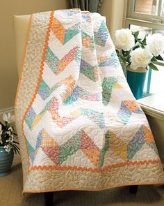 "Half-Square Triangles--- would make a great kid's quilt with different colored reads-as-plain ""zig-zag rows"" between the prints (as whites get so dirty)"