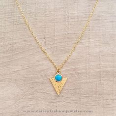Artificial Gold Toned Necklace, Gold Toned Necklace with Turquoise pendant.