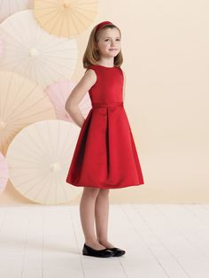 Sleeveless satin knee-length A-line dress with jewel neckline, bodice features a V-back accented with two bows, wide waistband, full pleated skirt, perfect as a girls holiday dress, a flower girl dress or party dress. Sister dress to style 214388.Sizes: 2 – 6