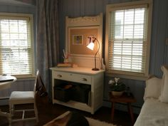 Remove the bottom two drawers of a dresser, and add file baskets. The old mirror  was changed into a bulletin board.