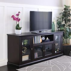 Display your entertaining space in style with this highboy media stand. Its four storage cabinets provide ample storage space to house your favorite movies, components, and game consoles. Features adj