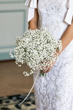 I struggled to find a bridal bouquet that I liked (picky, picky), but in the end, simple baby's breath was the winner.