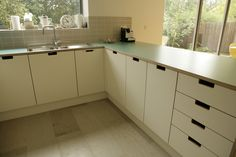 Formica kitchen incorporating grab handles with turquoise formica worktop - see more at http://mattantrobus.com/