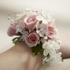 We've gone for a look that's classically feminine and graceful with this exquisite wrist corsage. Fresh roses in softest pink, dainty white stephanotis and delicate hyacinth flowers mingle with sparkling rhinestones to create a very beautiful adornment. If you would like to order this corsage or any of our floral arrangements for your #prom or #wedding day, give us a call on 0161 861 0524 and we'll be happy to help!