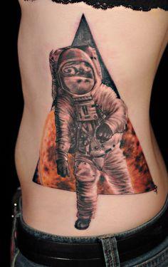 Astronaut Tattoo - http://99tattooideas.com/astronaut-tattoo/ #tattoo