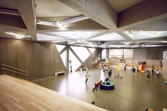 Kindergarten Lotte. Communal play space with cross hatching roof structure and skylights.