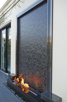 This grand vertical fire and water feature creates a compelling focal point for a courtyard in a private residence in Beverly Hills, CA. The mosaic water wall is made of granite, mosaic tile and stain Indoor Water Fountains, Indoor Fountain, Garden Fountains, Outdoor Fountains, Tabletop Fountain, Modern Water Feature, Backyard Water Feature, Indoor Water Features, Water Features In The Garden