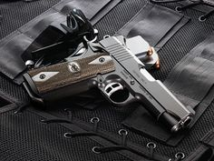 """Kimber Tactical Ultra II- """"Small and light enough for backup, perfect for concealed carry.""""     Caliber: .45 ACP      Height (inches) 90° to barrel: 5.00      Weight (ounces) with empty magazine: 25      Length (inches): 6.8      Magazine capacity: 7      Magazine well      Ambidextrous thumb safety      Recoil spring (pounds): 18.0      Full-length guide rod. MSRP $1,285.00"""