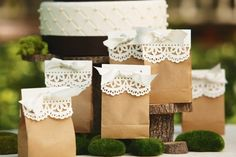 Paper bags, doilies and bows! Or you ca get white paper and use a border paper punch and make your own!
