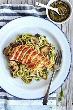 This savory Zucchini noodles recipe is topped with pesto, sautéed mushrooms, and chicken for an ultra-low in calorie, low-carb substitute for pasta. Pesto Zoodles, Pesto Zucchini Noodles, Zucchini Noodle Recipes, Chicken Noodle Recipes, Chicken Zucchini, Zoodle Recipes, Pesto Chicken, Recipe Zucchini, Zuchinni Recipes
