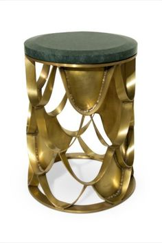 Koi Carp is a recurring symbol of Japanese culture. Its natural colour mutations reveal their capacity to adapt, just like KOI Side Table. With a base in brushed aged brass and a top in marble, this round side table will add refined elegance to any modern interior design.  #livingroomdesign #contemporarylivingrooms #modernlivingrooms #classiclivingrooms #mid-centurylivingrooms #eclecticlivingrooms