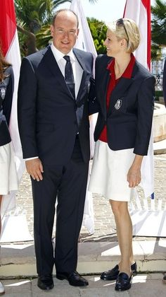 Prince Albert II of Monaco (L) and his wife Princess Charlene attend the presentation of Monaco's team for the London Olympics 2012, in Monte Carlo, on 12 July 2012.