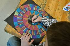 aztec suns... | Art Projects from MN Art Gal--construction paper crayons used on black paper.