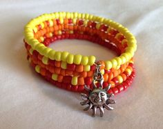 Red, Orange & Yellow summer inspired Memory Wire bracelet with a Sun charm.