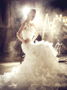 This wedding dress and photo are just stunning. I love the light and the look of it possibly being some sort of stage set. In some ways, every wedding is really a play.