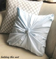 cute rosette pillow from thrift store sheet!