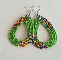 These colorful African Earrings are made using fine beads. They are 2 inches long without hooks. **Buy multiple items and pay shipping for 1 item only.The rest ships free. ON SALE Beaded earrings, African jewelry, handmade earrings, blue earrings, ZepJew Green Earrings, Seed Bead Earrings, Diy Earrings, Earrings Handmade, Crochet Earrings, Handmade Jewelry, Hoop Earrings, Diy Jewelry, Handmade Wire