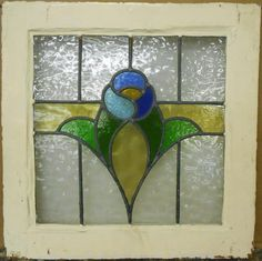 Another Old English leaded window with a floral design. Stained Glass Cabinets, Antique Stained Glass Windows, Stained Glass Door, Stained Glass Flowers, Stained Glass Designs, Stained Glass Panels, Stained Glass Projects, Stained Glass Patterns, Leaded Glass