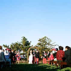 Ceremony decor Photography by katewebber.com #shepherdhooks #vintagepails #aislebouquets #gorgeousceremonyarch
